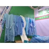 China Disposable Non Woven Disposable Surgical Gown Reinforced With Hand Towels on sale