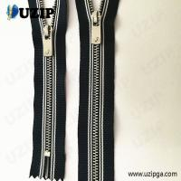 China No. 3 Striped cloth metal garment nickel zipper with fancy zipper pulls on sale