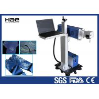China Online Flying Co2 Jeans Denim portable laser marking machine , small laser engraver on sale