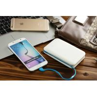 China Powerful Mobile Power Bank Charger with Build-in Cable and Dual USB Output on sale