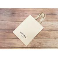 China Handmade OEM printed luxury Paper shopping bags SGS certified with matching color strong silk fabric Handle on sale