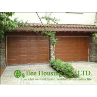 China Galvanized steel Sectional remote-controlled garage door For Condos, Wood color on sale