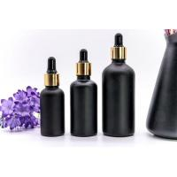 Buy cheap Personal Care Black Printing Essential Oil Glass Bottle with Gold Collar Hot Sale from wholesalers